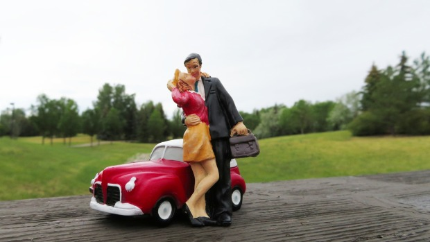 statue man in suit with briefcase, kissing wife, car in background, Pixabay image, Mary J McCoy-Dressel, blog post, week 22, 52 week blog challenge