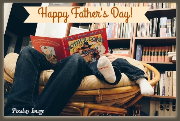 library books on wall shelf, father and son sitting in comfortable chair with a book, faces covered with the book, Mary J McCoy-Dressel, post for Father's Day
