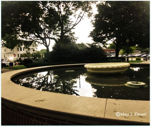 Fountain with water, white Queen Anne style home in the background, Mary J McCoy-Dressel, Wordless Wednesday Blog Post